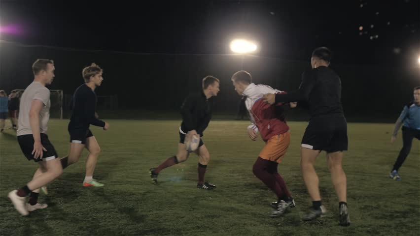 Workout of rugby professional team outdoor at night, football training | Shutterstock Video #30419641