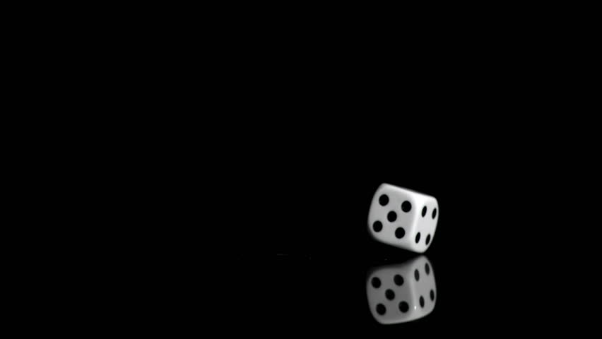 One white dice in a super slow motion even turning on against a black background | Shutterstock HD Video #3042646
