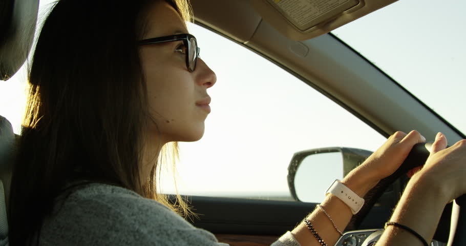 Woman happyily driving in car - slow motion | Shutterstock HD Video #30444841