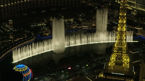 Las Vegas - May 2017: Aerial illuminated night view of Las Vegas Strip Bellagio Fountains Eiffel Tower Resort Hotels and city Casinos Nevada USA RED WEAPON