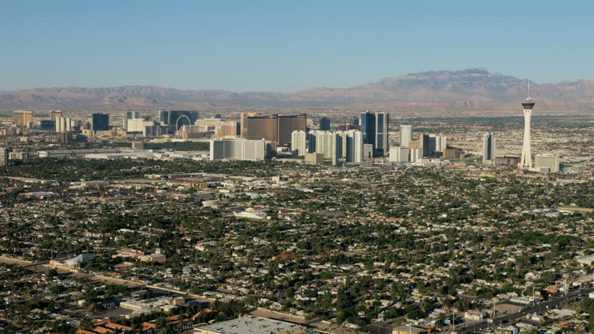 Las Vegas - May 2017: Aerial Cityscape view of Downtown Resort hotels and Casinos city homes residential suburbs Nevada USA RED WEAPON