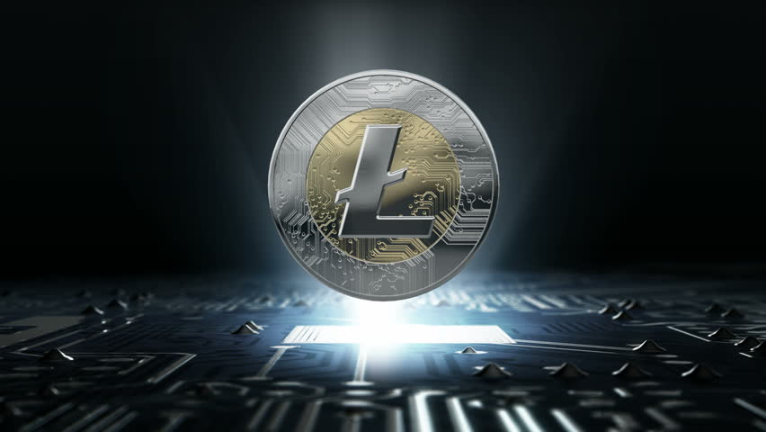 A loop able rotating lifecoin cryptocurrency in hologram form hovvering over a computer circuit board | Shutterstock HD Video #30469831