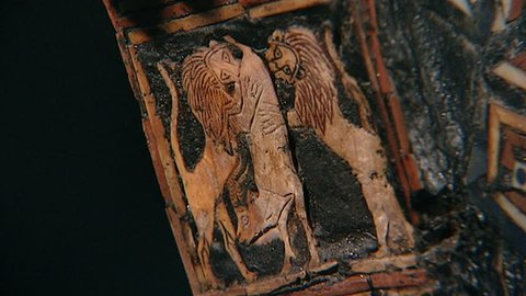 BAGHDAD, IRAQ - CIRCA 2002: The Golden Bull Lyre of Ur c. 2450 BCE. ECU inlay detail decorating the lyre showing lions tearing into a gazelle. From the Sumerian collection Iraq Museum.