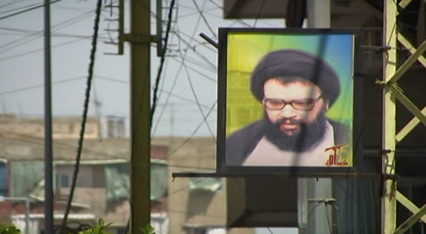 BEIRUT, LEBANON - CIRCA 2005: Framed photo hanging on a pylon of late Shia cleric Abbas al-Musawi who was the co-founder and Secretary General of Hezbollah until 1992
