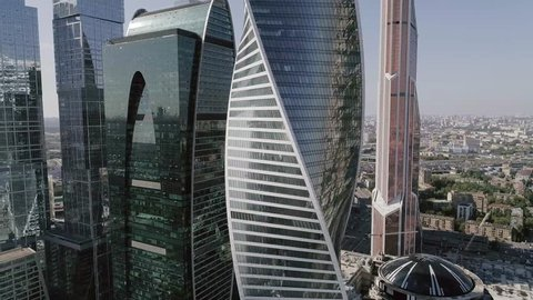 Business Center Moscow City. Spans next to the skyscrapers. Aerial photography of the Moscow shopping center. Glass skyscrapers shot in a bright sunny day with glare on the glass. Moscow summer 2017.