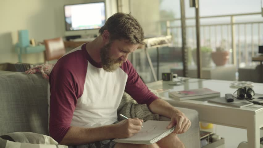 Man drawing / Developing a new project / Creative apartment in Venice at the beach | Shutterstock HD Video #30563701