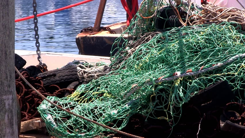 MENEMSHA HARBOR, MARTHA'S VINEYARD - JULY 14th;  Nets and rigging on deck of fishing boat at quaint fishing village July 14th, 2012 MENEMSHA, MA