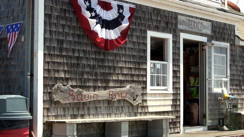 MENEMSHA HARBOR, MARTHA'S VINEYARD - JULY 14th;  A small store along water front of quaint fishing village provides convenient items for tourists and fisherman July 14th, 2012 MENEMSHA, MA