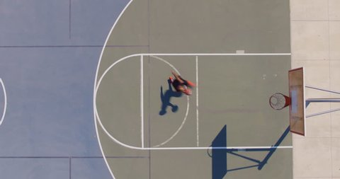 Man Playing Basketball at Park Outside, Overhead Shot