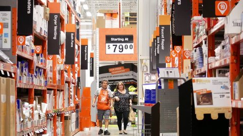 Port Coquitlam, BC, Canada - September 07, 2017 : Motion of customer and clerk walking to faucet and sink repair products corridor in Home Depot store with 4k resolution