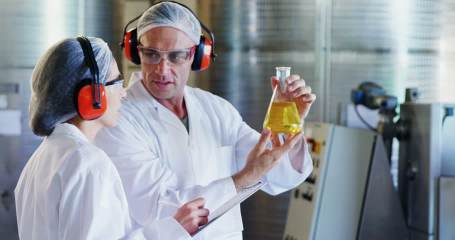 Technicians examining olive oil in factory | Shutterstock HD Video #30621031