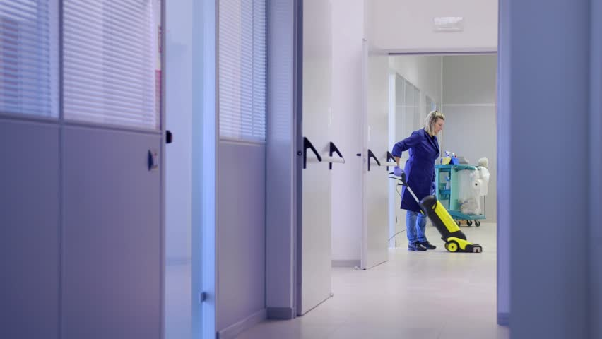Woman working, professional maid cleaning and washing floor with machinery in industrial building. Sequence