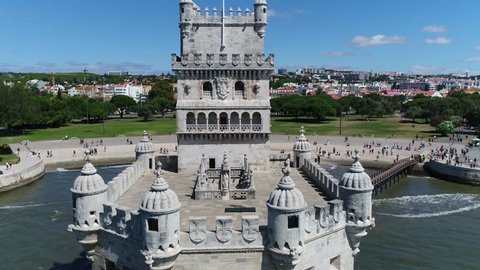 Aerial of Belem Tower flying over  the fortified tower located in the civil parish of Santa Maria de Belem in the municipality of Lisbon Portugal it is a UNESCO World Heritage Site 4k resolution