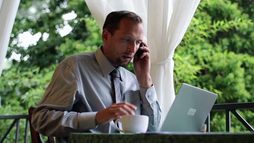 Angry businessman with cellphone working on his balcony at home  | Shutterstock HD Video #3067081