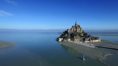 Flight above the Mont-Saint-Michel - one of Europe's most unforgettable sights. Set in the mesmerising bay where Normandy and Brittany merge, the island draws the eye from great distances.