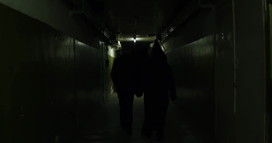 A frightening man in a mask in a long hallway 4k | Shutterstock HD Video #30707281