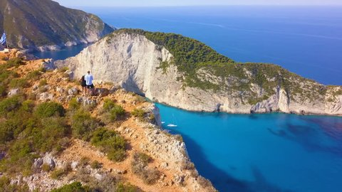 Aerial footage of a romantic couple visiting Navagio Beach (Shipwreck beach).