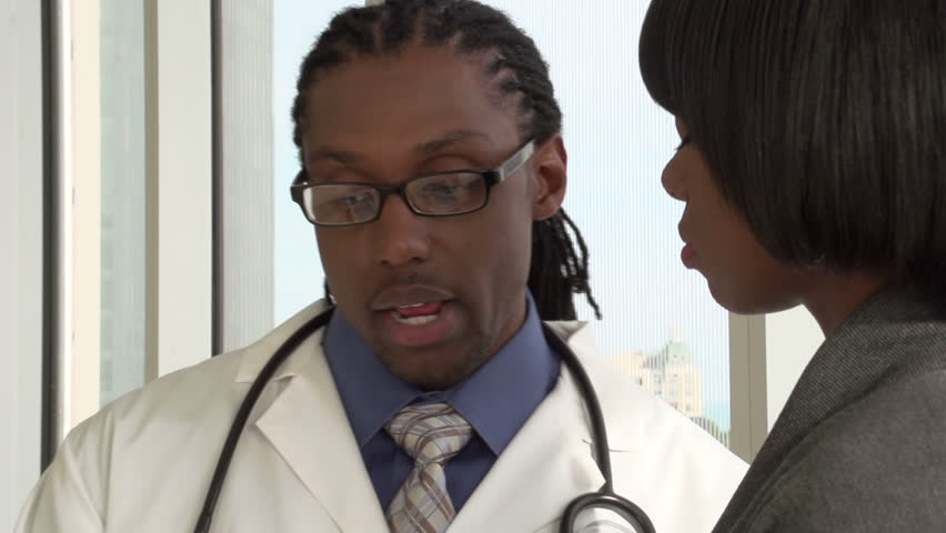 Doctor talking with patient, close up
