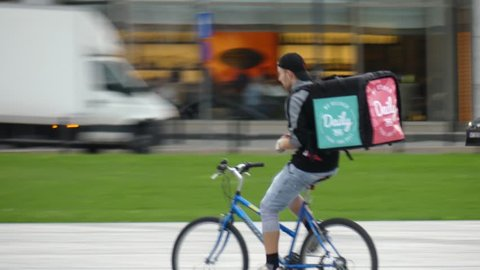 WARSAW, POLAND - SEPTEMBER 14, 2017. Bicycle food delivery courier