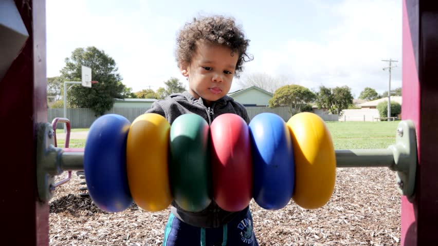 Black child plays with color toys and walk off