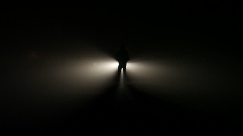 Figure of a man emerges from the light.