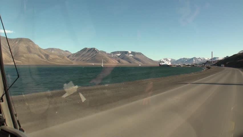 Road on coastline in Arctic Ocean. Wilderness. Extreme tourism and travel in the cold polar north. Scenic picturesque and blue water on background of snowy mountains. | Shutterstock HD Video #30781171