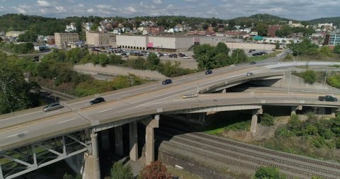 A daytime high angle aerial establishing shot of traffic on Route 51 in Rochester, Pennsylvania.