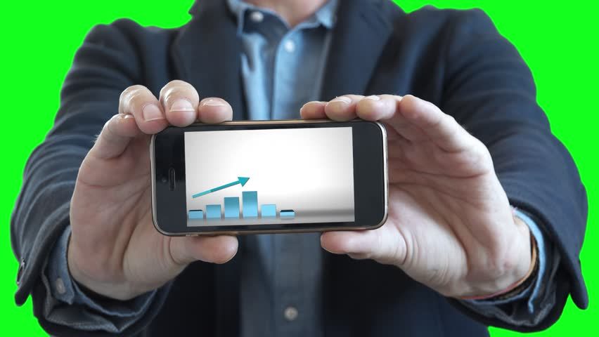 Business Success Presentation In Smartphone, Green Screen. Man holding a smartphone with a positive chart in a business presentation | Shutterstock HD Video #30801322