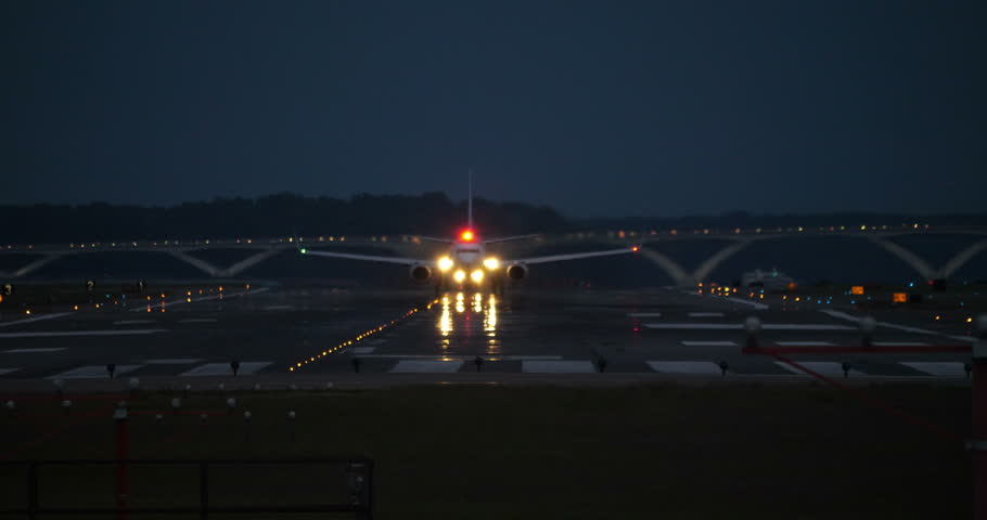 Washington DC September 2017 : Airplane Taking off Reagan National Airport at Dusk Bright Lights