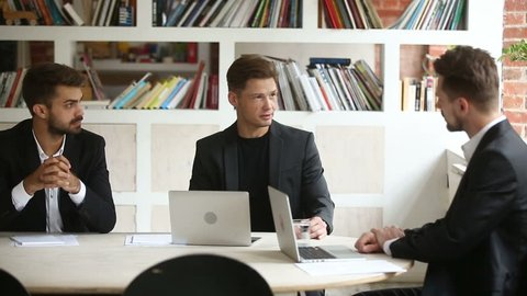 Company boss explaining new project strategy to executive manager at meeting, successful entrepreneur presenting business offer to partner in office, investor discussing deal negotiating with client