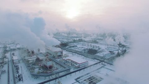 Aerial view of gas processing plant at winter time. Cold morning at industrial zone