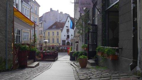 TALLINN, ESTONIA - AUGUST 20, 2017: Walking down the narrow street in the old town of Tallinn, Estonia