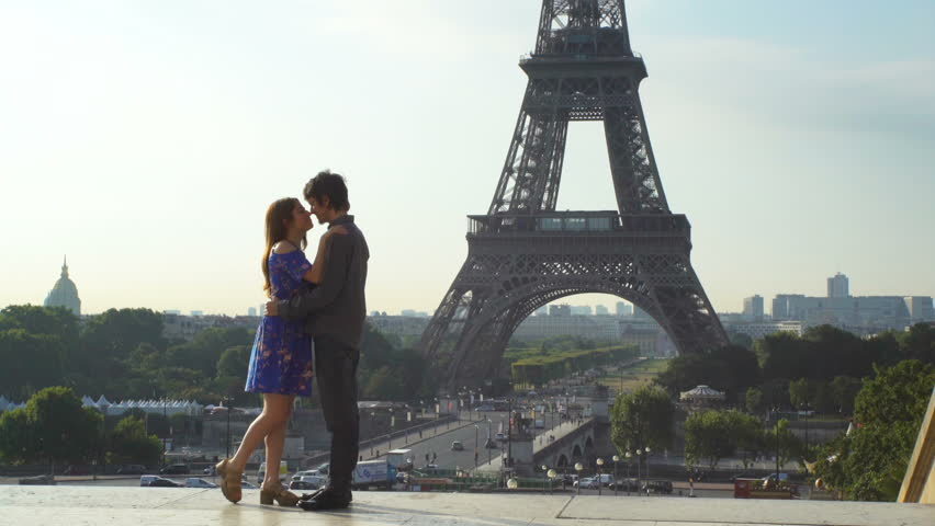 PARIS, FRANCE - JULY 26,2017: loving couple kissing on Eiffel Tower background | Shutterstock HD Video #30867751
