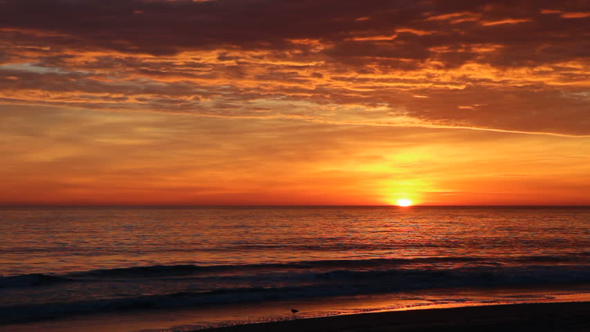 Dramatic orange sunrise over the beach at Nags Head on the Outer Banks of North Carolina to start a beautiful fall day in November #3088711