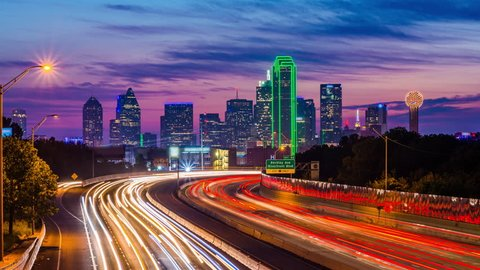 Dallas, Texas, USA downtown skyline and highway.