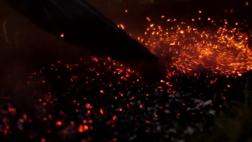The man dropped the coals by night | Shutterstock HD Video #30902791