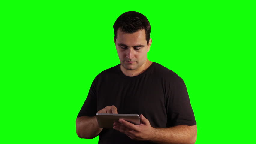Young Man Tablet PC Greenscreen   Footage was shot against green screen and is keyed out. The bg is pure green, removing the green is only 1 click. Green spills are removed.
