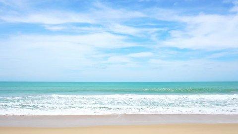 tropical andaman seascape scenic off kata beach phuket thailand with wave crashing on sandy shore