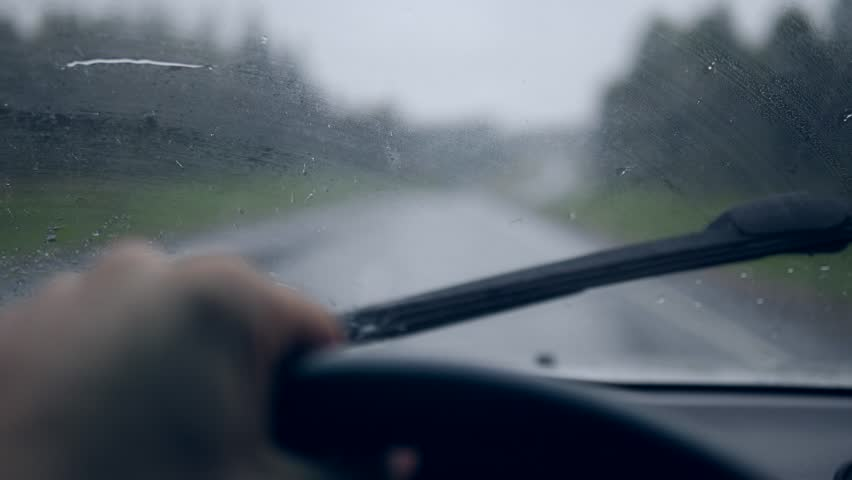 Rain Drops on Windshield During Storm. Driving in bad weather pov. 4K slowmotion.