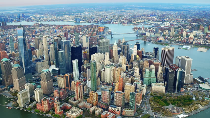 Aerial view of the Financial District. Famous Skyscrapers in Lower Manhattan. Brooklyn and Manhattan Bridge in the background. New York City, United States. Shot from a helicopter. | Shutterstock HD Video #30979852