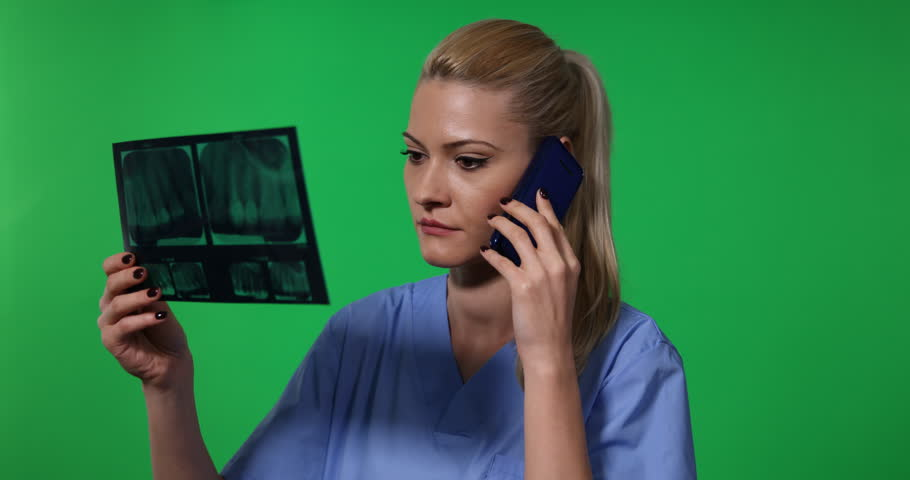 Dentist Woman Talk Mobile Phone Hold X-Ray Negative News Green Screen Background | Shutterstock HD Video #30995521
