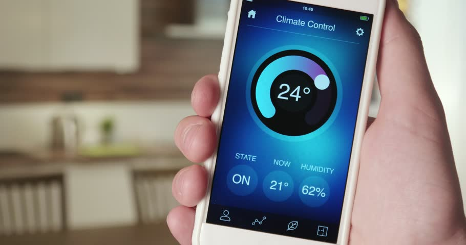 Smartphone Home Control smart house, home automation, device with app icons. man uses his