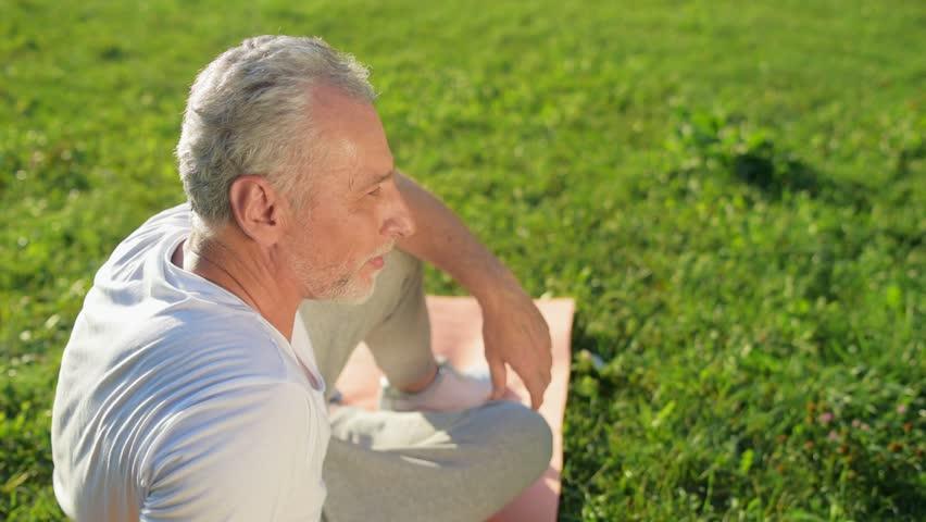 Positive elderly man resting after sport exercises | Shutterstock HD Video #31034962