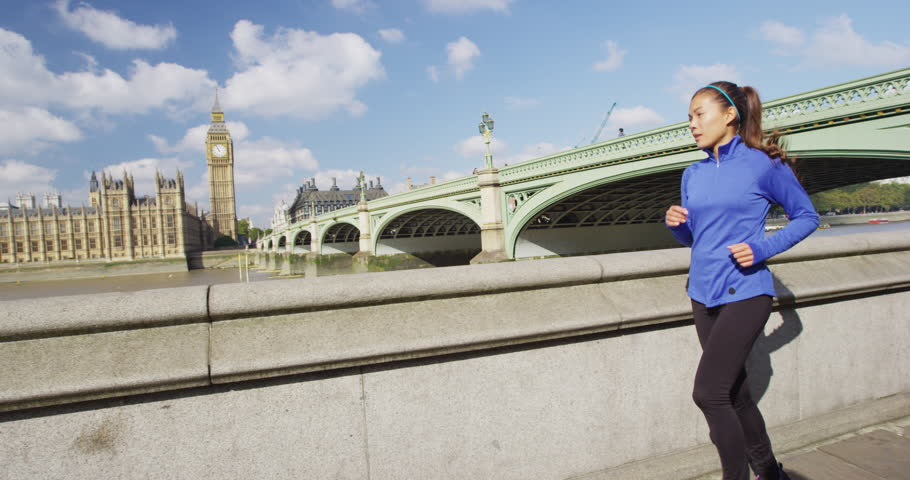 London running woman training for marathon. Sport girl jogging in city near Big Ben and Westminster bridge, exercising on the way to work. Morning workout to the office. SLOW MOTION. | Shutterstock HD Video #31039153