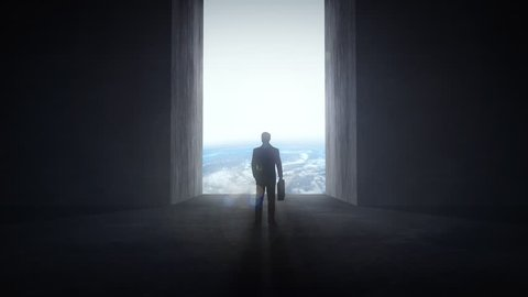 Businessman standing at an opening wall that reveals the Earth, motivation concept