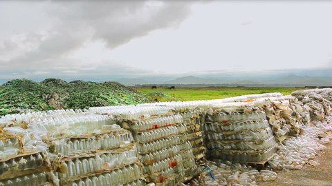 Plastic bottles at the landfill ready for recycle. Large quantity of plastic bottles at the landfill ready for recycling