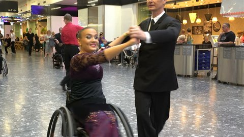 HELSINKI, FINLAND - AUGUST 19, 2017: Couples with disabilities perform ballroom dance. One of the spouses in a wheelchair. Festival for all lovers of dance Let's Dance Helsinki.