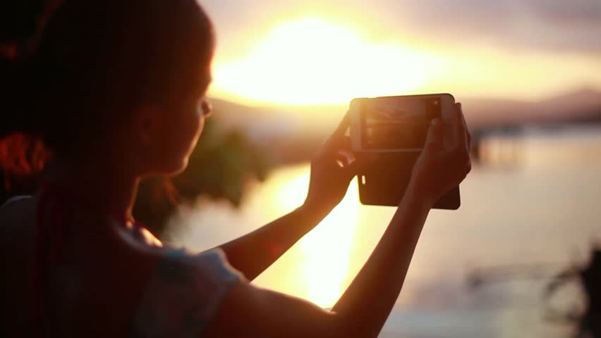 Young woman taking photo of the sunset with her phone on tropical beach of Koh Samui. 1920x1080 | Shutterstock HD Video #31108585
