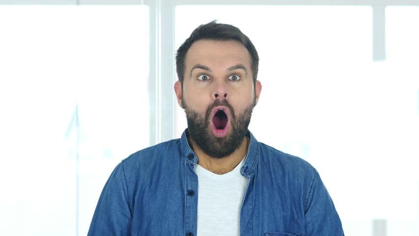 Amazed by Surprise Man Sitting in Office | Shutterstock HD Video #31125871