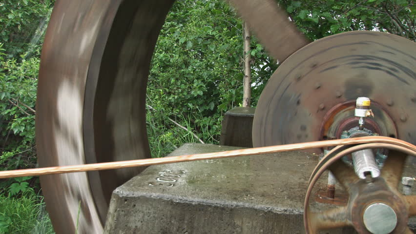 Pulley and belt driving a grindstone, waterwheel powered.   Shutterstock HD Video #3114271